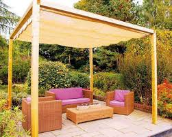 Simple Backyard Landscaping Ideas by Stylish Wooden Pergola And Stamped Patio Floor For Simple Backyard