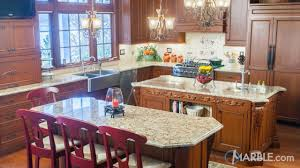 kitchen island design tips granite is a great countertop meterial for large high traffic kitchens like this one