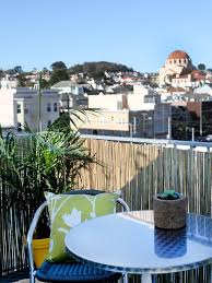 balcony privacy ideas with bamboo plants and reed mats
