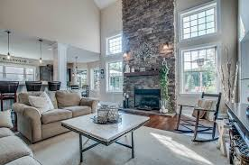 rustic living room with high ceiling u0026 metal fireplace in franklin