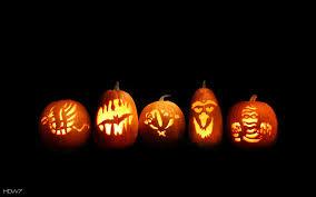 halloween five carved pumpkins jack o lanterns lights glowing