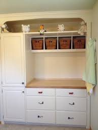 i tore out the closet and built in a changing table with drawers