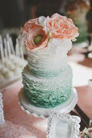 peach ombre wedding cake picture of ruffle ombre mint wedding cake topped with peach flowers