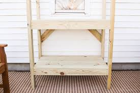 diy potting bench with decorative roof love grows wild