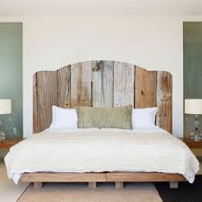 using a queen headboard with a rustic king bed editeestrela design