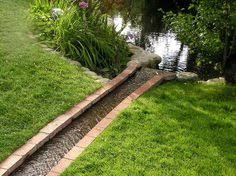 Backyard Drainage Ideas Three Dogs In A Garden Clever Drainage Art My Garden Diaries