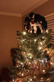 my gift doubles as a tree topper merry