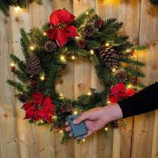 outdoor green battery pre lit wreath with poinsettias