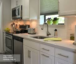 white shaker style cabinets in a galley kitchen homecrest