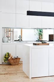 kitchen matt white handleless cabinets mirror splashback long