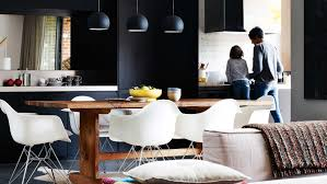 modern kitchen black modern kitchen black cabinetry pendant lights timber dining table