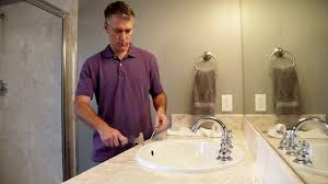 how to remove caulk from a shower sink or bathtub youtube