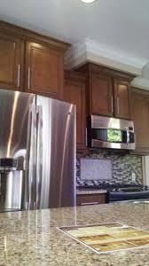 Floor And Decor Cabinets by Furniture Peru Aristokraft Cabinets With Frige And Oven Plus Tile