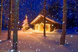 winter of heavy falling snow and a historic log cabin with
