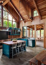 blue kitchen cabinets in cabin rustic cabin in the woods town country living