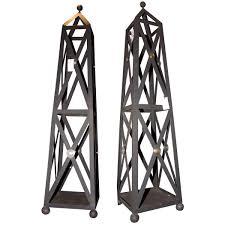 a pair of painted metal obelisk form garden trellises height 6