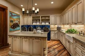 farmhouse floors traditional laundry room with built in bookshelf chandelier