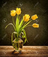 Yellow Glass Vase Yellow Tulips In Glass Vase With Rustic Wood Background Stock