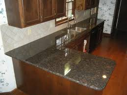 Tan Brown Granite Countertops With  X  Rialto Beige Ceramic Tile - Granite tile backsplash ideas