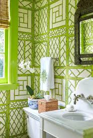 green powder room with green trellis bamboo wallpaper