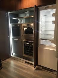 cabinet pocket door kitchen cabinets hiding a kitchen behind
