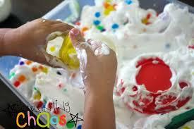 cream and water beads sensory bin