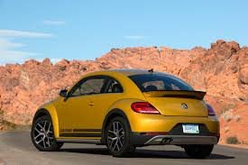 yellow baja bug volkswagen launches new beetle models denim and rugged dune
