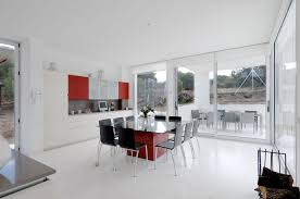 square glass dining table top on red glossy base and black chairs