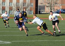 Coed Flag Football League File Us Navy 111202 N Fc065 001 Cmdr Bill Mallory Tries For More