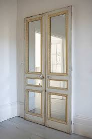 Impact Plus Closet Doors Pair Of Doors With Mirror Inserts Against A Plain Wall Or On