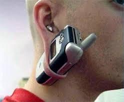 strange earrings mobile phone earrings worlds smallest phone pictures pics