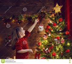 is decorating the christmas tree stock photo image 78568666