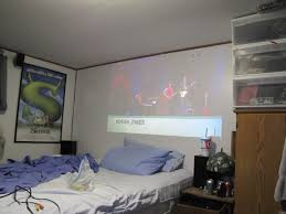 projector vs tv home theater living room projector setup bedroom screen curtain home theater in