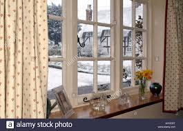 winter snow scene england uk gloomy outlook viewed from a window