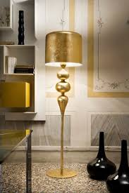 gold lamps with golden lamp shades by masiero