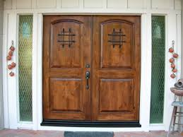 best double front doors with arch top paneling combined carving