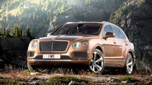 gold bentley bentley gives the world its first ultra luxury suv wired