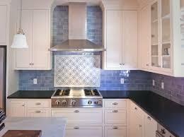 sink faucet kitchen backsplash subway tile mirorred glass pattern