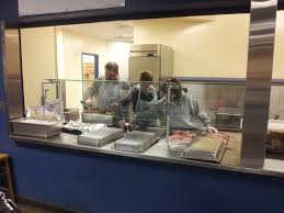 volunteers serve breakfast at st vincent depaul dining room in