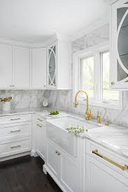what hardware for white kitchen cabinets white cabinets with polished brass hardware transitional