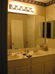 fascinating bathroom vanity lights emitting elegant illumination awesome vanity painted in white enlightened by simple bulb bathroom vanity lights combined with twin oval