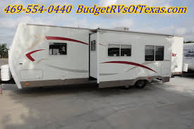 2007 fleetwood prowler 280fqs that is very spacious and camp ready