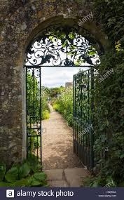 the decorative wrought iron gate and cotswold stone archway