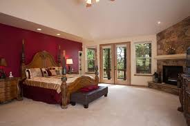 Master Bedroom With Fireplace Rustic Master Bedroom With Ceiling Fan U0026 Stone Fireplace In