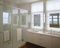 mirrors in front of windows contemporary bathroom hutker