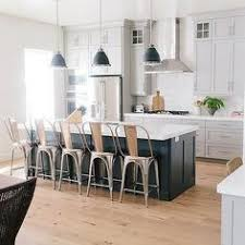 white kitchen with island kitchen with wood beams white cabinets subway tile and hardwood