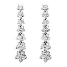dangle diamond earrings flower petal diamond earrings drop dangle wixon jewelers