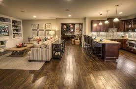 open floor plan kitchen and living room the upscale downstairs building a better basement open plan