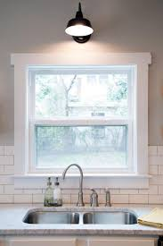 kitchen glass window design with white window frame plus marble