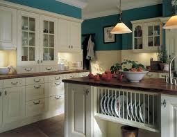 white wooden kitchen cabinet placed on the white wall also cream